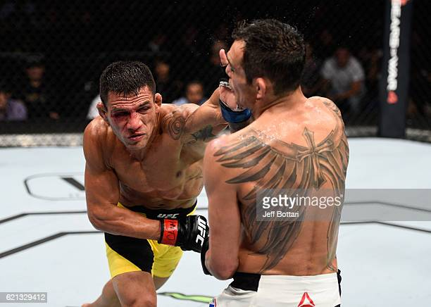 Rafael Dos Anjos of Brazil punches Tony Ferguson of the United States in their lightweight bout during the UFC Fight Night event at Arena Ciudad de...
