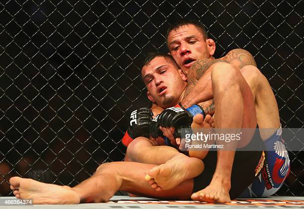 Rafael dos Anjos top fights with Anthony Pettis in the Lightweight Title bout during the UFC 185 event at American Airlines Center on March 14 2015...