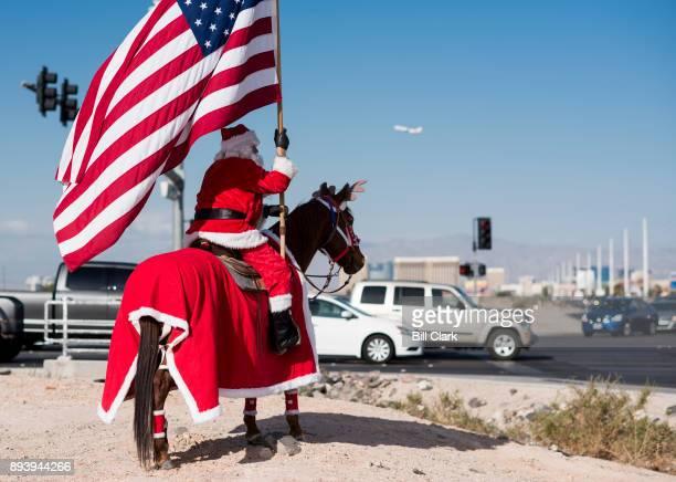 Rafael Evelio Sarabia dressed as Santa Claus on horseback waves to passing traffic along Las Vegas Blvd in Las Vegas on Saturday Dec 16 2017 Manually...