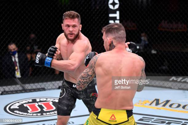 Rafael Fiziev of Kyrgyzstan punches Renato Moicano of Brazil in their lightweight bout during the UFC 256 event at UFC APEX on December 12, 2020 in...