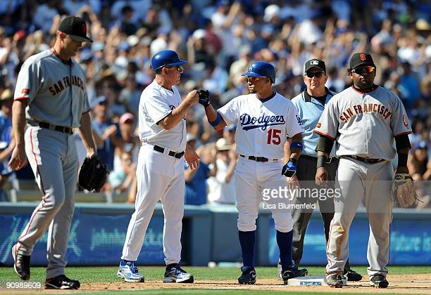 Rafael Furcal of the Los Angeles Dodgers celebrates with coach Larry Bowa after hitting a triple in the seventh inning against the San Francisco...
