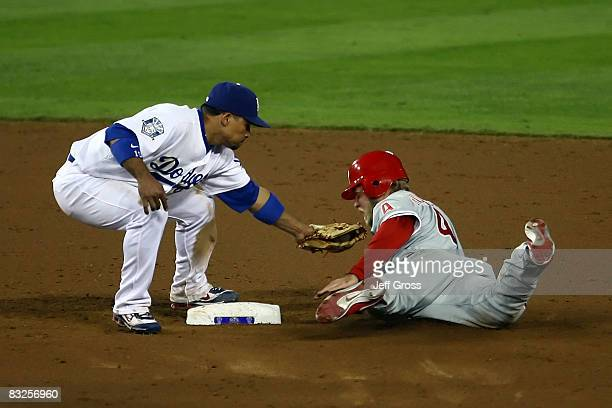 Rafael Furcal of the Los Angeles Dodgers tags out Eric Bruntlett of the Philadelphia Phillies as he is caight stealing in the ninth inning of Game...