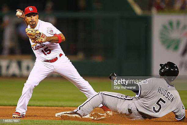 Rafael Furcal of the St Louis Cardinals turns a double play over Orlando Hudson of the Chicago White Sox at Busch Stadium on June 13 2012 in St Louis...