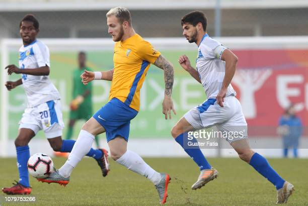 Rafael Furlan of GD Estoril Praia with Bruno Alves of FC Arouca in action during the Ledman Liga Pro match between GD Estoril Praia and FC Arouca at...