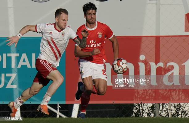Rafael Furlan of UD Vilafranquense competes for the ball with Joao Ferreira of SL Benfica B during the Liga Pro match between SL Benfica B and UD...