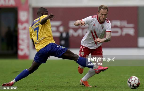 Rafael Furlan of UD Vilafranquense with Chiquinho of GD Estoril Praia in action during the Liga Pro match between GD Estoril Praia and UD...