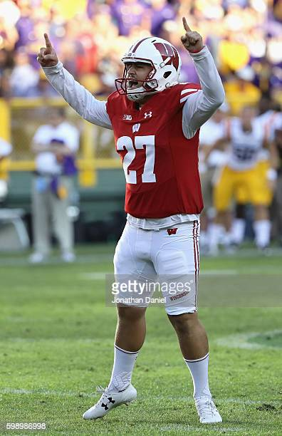 Rafael Gaglianone of the Wisconsin Badgers celebrates after making a 47yard field goal during the fourth quarter to give the Wisconsin Badgers a 1614...