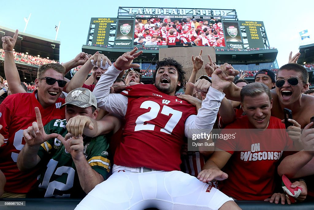 Rafael Gaglianone #27 of the Wisconsin Badgers celebrates with fans after beating the LSU Tigers 16-14 at Lambeau Field on September 3, 2016 in Green Bay, Wisconsin.