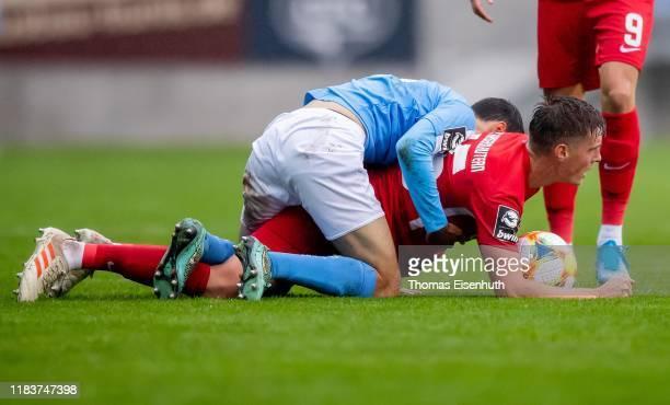 Rafael Garcia Doblas of Chemnitz and Carlo Sickinger of Kaiserslautern battles for the ball during the 3. Liga match between Chemnitzer FC and 1. FC...