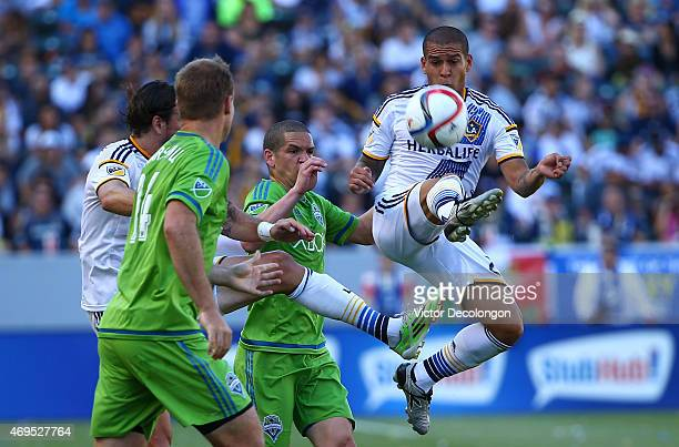 Rafael Garcia of Los Angeles Galaxy volleys the ball from Osvaldo Alonso of Seattle Sounders FC in the first half of the MLS match at StubHub Center...