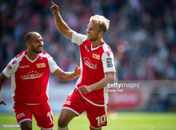 Rafael Gikiewicz and Sebastian Andersson of 1.FC Union Berlin celebrate after scoring the 3:0 during the 2nd Bundesliga match between Union Berlin...