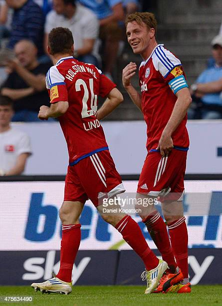 Rafael Kazior of Kiel celebrates his team's first goal with team mate Jaroslaw Lindner during the 2 Bundesliga playoff second leg match between 1860...