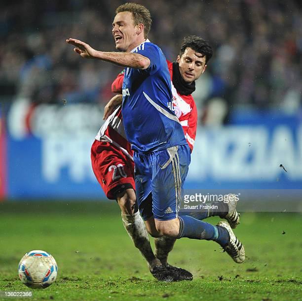 Rafael Kazior of Kiel is challenged by Telmo Teixeira Rebelo of Hallescher during the regional north league match between Holstein Kiel and...