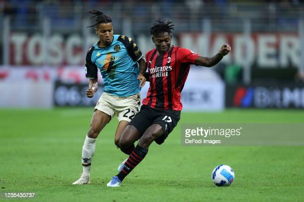 Rafael Leao of AC Milan and Tyronne Ebuehi of Venezia FC battle for the ball during the Serie A match between AC Milan and Venezia FC at Stadio...