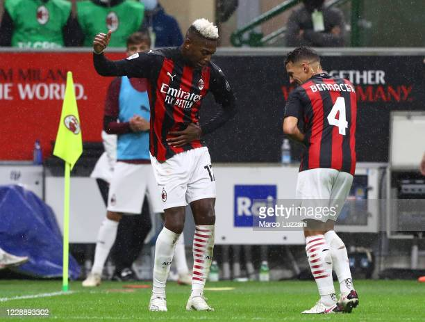 Rafael Leao of AC Milan celebrates his second goal with his team-mate Ismael Bennacer during the Serie A match between AC Milan and Spezia Calcio at...