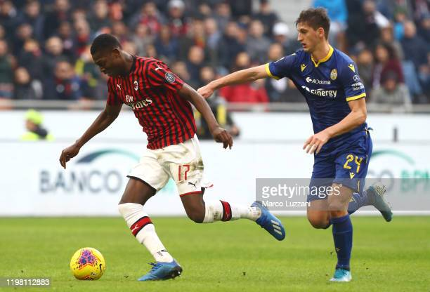 Rafael Leao of AC Milan cis challenged by Marash Kumbulla of Hellas Verona during the Serie A match between AC Milan and Hellas Verona at Stadio...