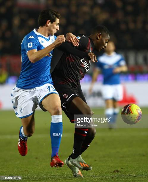 Rafael Leao of AC Milan competes for the ball with Andrea Cistana of Brescia Calcio during the Serie A match between Brescia Calcio and AC Milan at...