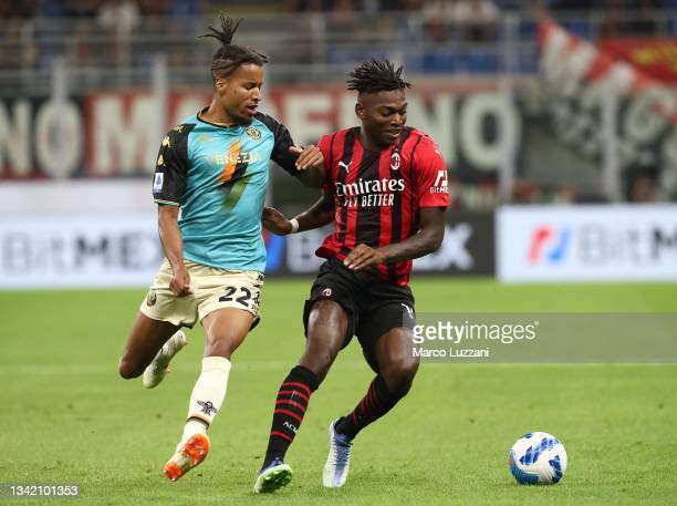 Rafael Leao of AC Milan competes for the ball with Tyronne Ebuehi of Venezia FC during the Serie A match between AC Milan and Venezia FC at Stadio...