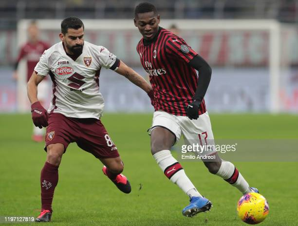 Rafael Leao of AC Milan is challenged by Tomas Rincon of Torino FC during the Coppa Italia Quarter Final match between AC Milan and Torino at San...