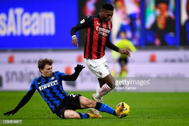 Rafael Leao of AC Milan is tackled by Nicolo Barella of FC Internazionale during the Coppa Italia football match between FC Internazionale and AC...