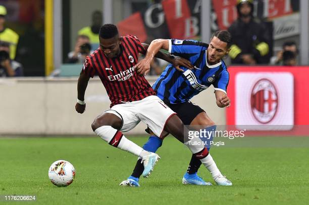 Rafael Leao of Milan and Danilo D'Ambrosio of Internazionale compete for the ball during the Serie A match between AC Milan and FC Internazionale at...