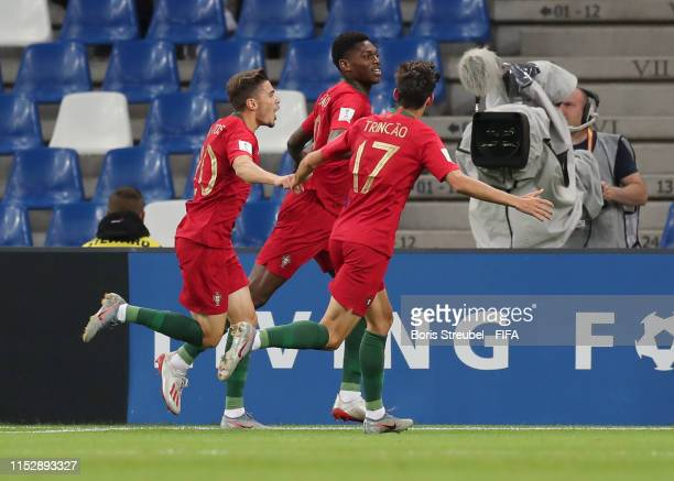 Rafael Leao of Portugal celebrates with team mates after scoring their team's first goal during the 2019 FIFA U20 World Cup group F match between...