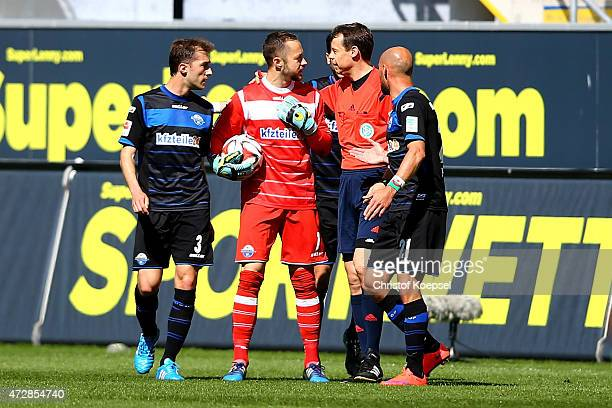 Rafael Lopez Gomez Lukas Kruse Moritz Stoppelkamp and Daniel Brueckner of Paderborn discuss with referee Markus Schmidt after the decison for the...