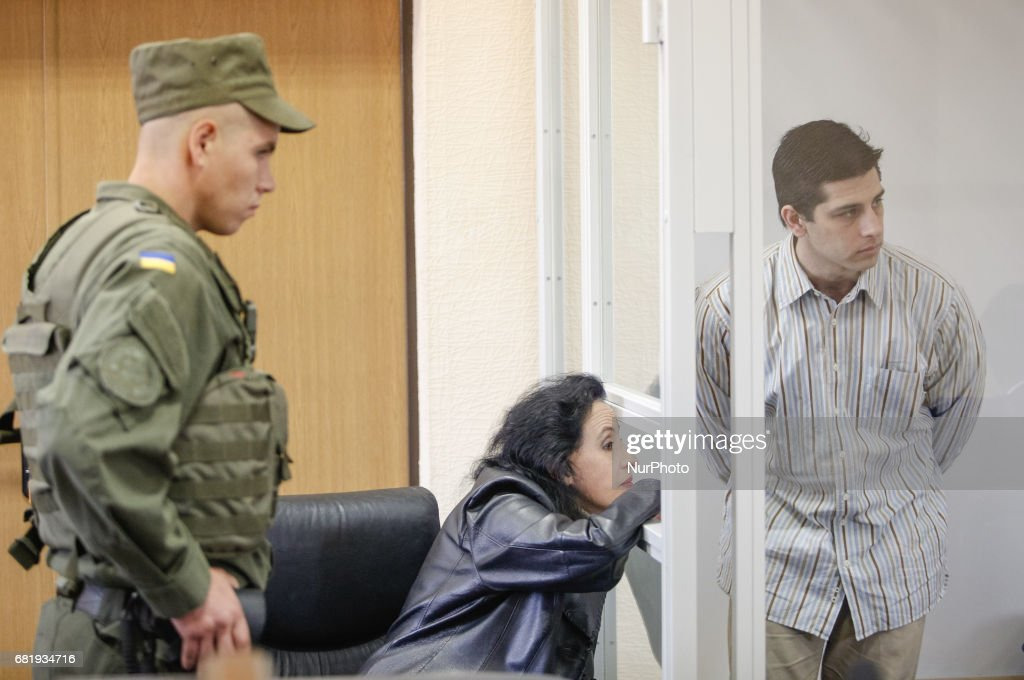 Rafael Lusvarghi (R) is seen in the courtroom cage in Kyiv, Ukraine, May 11, 2017. Appeal court of Kyiv hears the case on Brazilian Rafael Lusvarghi sentenced for 13 years of fighting together with Russia-backed separatists in Ukraine.