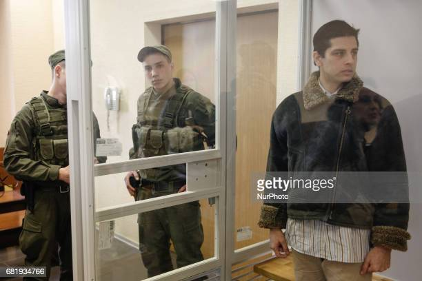Rafael Lusvarghi is seen in the courtroom cage in Kyiv Ukraine May 11 2017 Appeal court of Kyiv hears the case on Brazilian Rafael Lusvarghi...