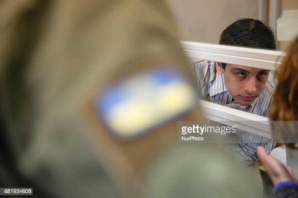 Rafael Lusvarghi is seen talking to his lawyer from the courtroom cage during the trial in Kyiv Ukraine May 11 2017 Appeal court of Kyiv hears the...