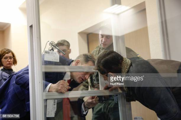 Rafael Lusvarghi is seen talking to his lawyer Valentyn Rybin from the courtroom cage during the trial in Kyiv Ukraine May 11 2017 Appeal court of...