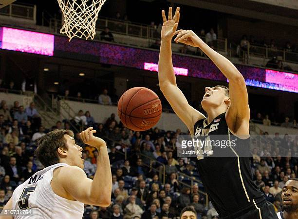 Rafael Maia of the Pittsburgh Panthers fouls Konstantinos Mitoglou of the Wake Forest Demon Deacons during the game at Petersen Events Center on...