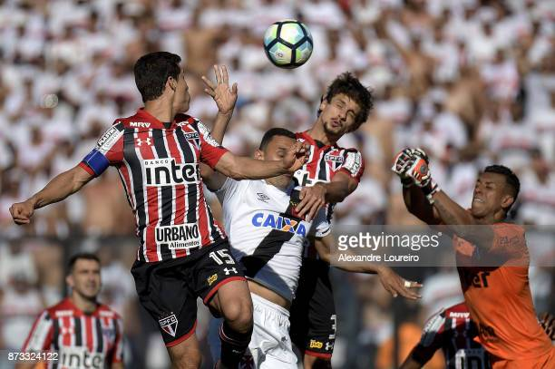 Rafael Marques of Vasco da Gama struggles for the ball with Hernanes Rodrigo Caio and Sidão of Sao Paulo during the match between Vasco da Gama and...
