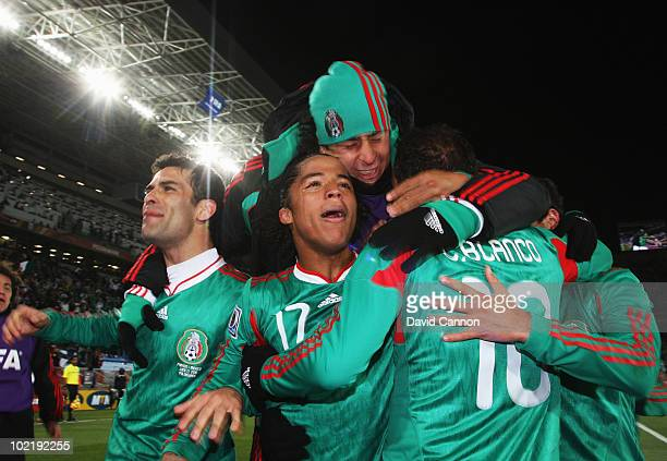 Rafael Marquez and Giovani Dos Santos of Mexico celebrate with Cuauhtemoc Blanco after he scored a penalty for his team's second goal during the 2010...