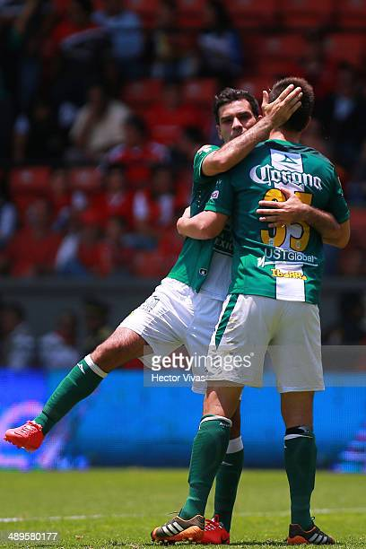 Rafael Marquez and Juan Gonzalez of Leon celebrate after winning the Semifinal second leg match between Toluca and Leon as part of the Clausura 2014...