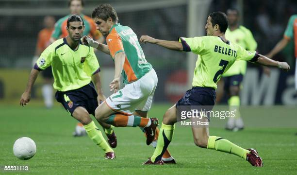 Rafael Marquez and Juliano Belletti of Barcelona challengesIvan Klasnic of Bremen during the UEFA Champions League Group C match between Werder...