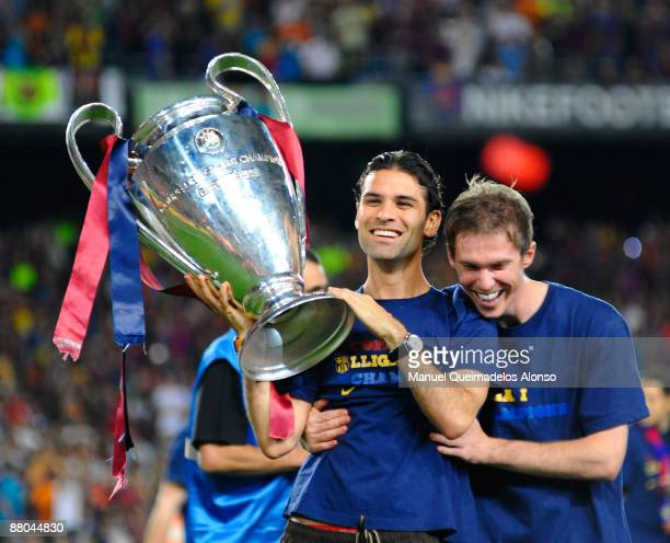 Rafael Marquez holds the UEFA Champions League trophy with Aleksander Hleb at the Nou Camp stadium the day after Barcelona won the UEFA Champions...