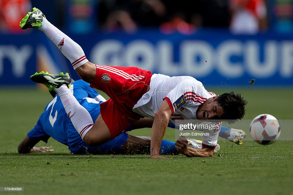 Rafael Marquez Lugo #11 of Mexico is fouled by Sebastien Cretinoir #21 of Martinique during the second half of a CONCACAF Gold Cup match at Sports Authority Field at Mile High on July 14, 2013 in Denver, Colorado. Mexico defeated Martinique 3-1.