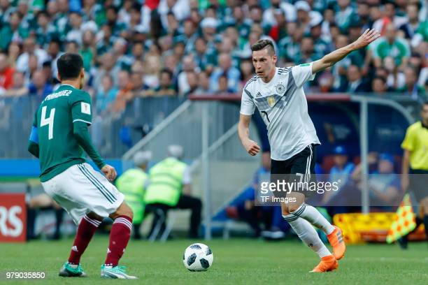 Rafael Marquez of Mexico and Julian Draxler of Germany battle for the ball during the 2018 FIFA World Cup Russia group F match between Germany and...