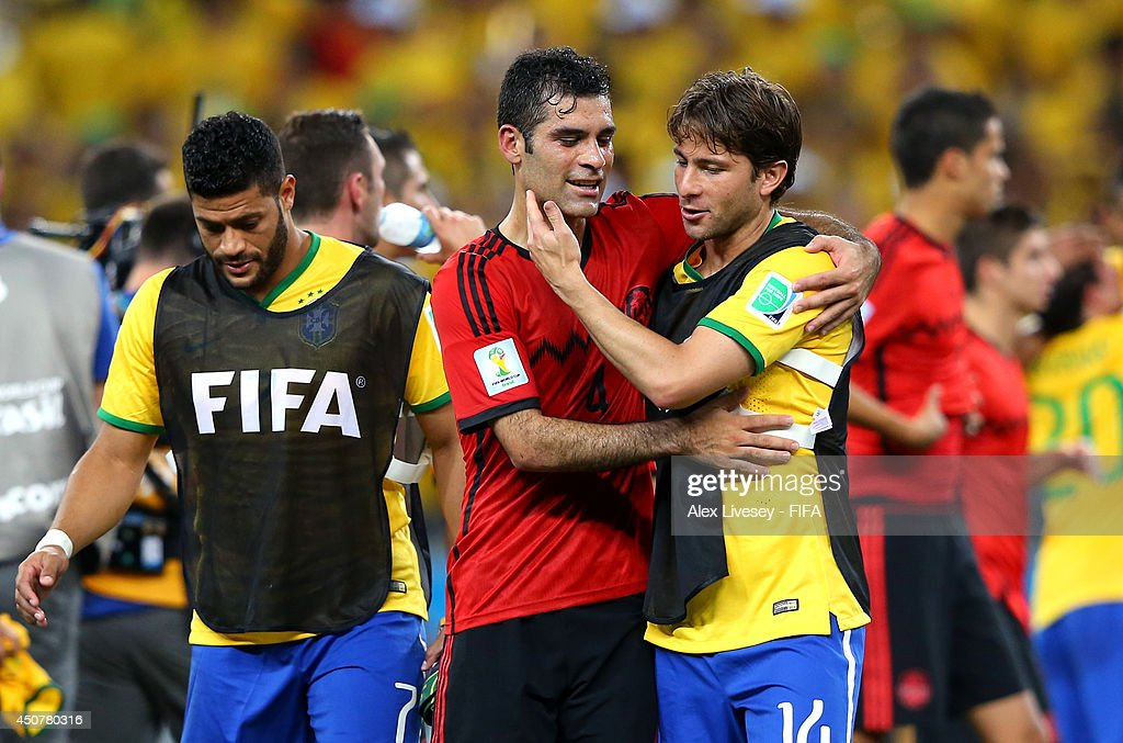 Rafael Marquez of Mexico and Maxwell of Brazil hug each other after the 2014 FIFA World Cup Brazil Group A match between Brazil and Mexico at Estadio Castelao on June 17, 2014 in Fortaleza, Brazil.