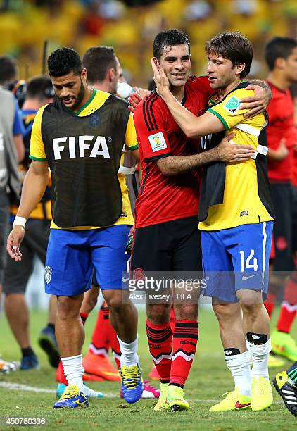 Rafael Marquez of Mexico and Maxwell of Brazil hug each other after the 2014 FIFA World Cup Brazil Group A match between Brazil and Mexico at Estadio...