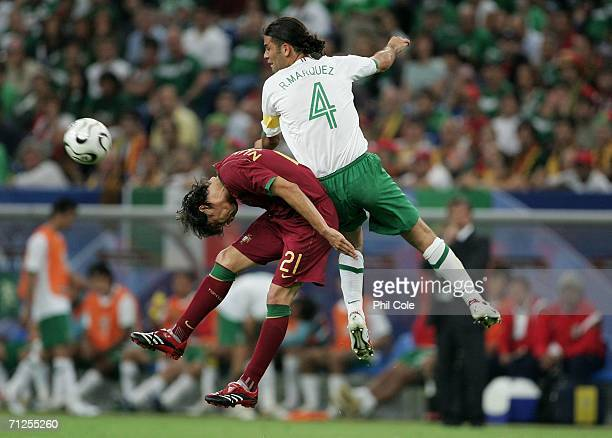 Rafael Marquez of Mexico battles for the header with Nuno Gomes of Portugal during the FIFA World Cup Germany 2006 Group D match between Portugal and...