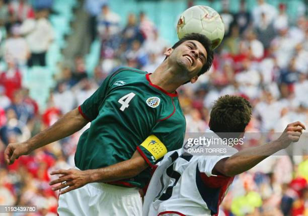 Rafael Marquez of Mexico beats the USA's Josh Wolff to the ball, 17 June 2002 at the Jeonju World Cup Stadium in Jeonju, during second round playoff...