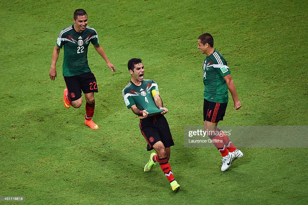 Rafael Marquez of Mexico (center) celebrates scoring his team's first goal during the 2014 FIFA World Cup Brazil Group A match between Croatia and Mexico at Arena Pernambuco on June 23, 2014 in Recife, Brazil.
