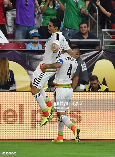 Rafael Marquez of Mexico celebrates with Raul Jimenez after scoring the second goal of his team during a group C match between Mexico and Uruguay at...