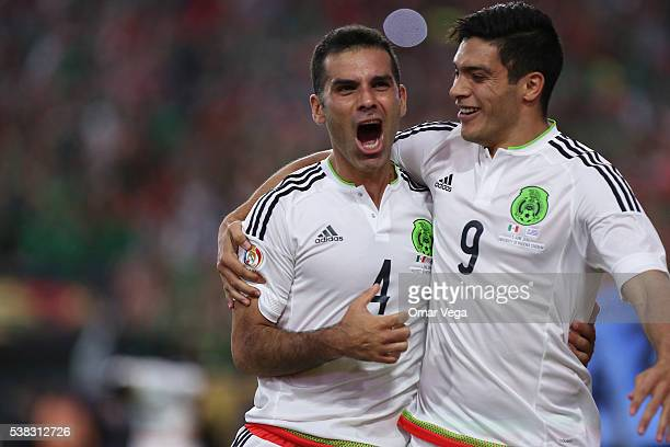 Rafael Marquez of Mexico celebrates with teammate Raul Jimenez after scoring the second goal of his team during a group C match between Mexico and...