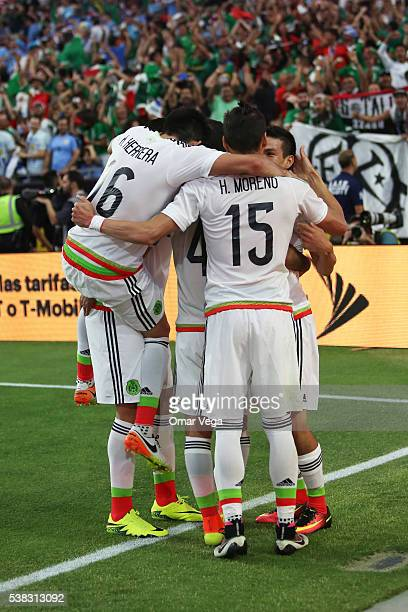 Rafael Marquez of Mexico celebrates with teammates after scoring the second goal of his team during the second half of a group C match between Mexico...