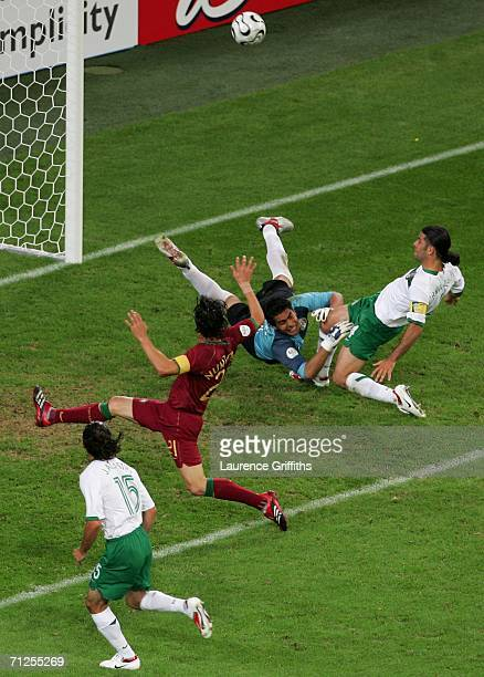 Rafael Marquez of Mexico colides with team mate goalkeeper Oswaldo Sanchez as he clears the ball during the FIFA World Cup Germany 2006 Group D match...