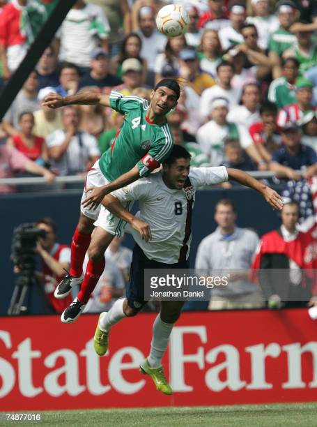 Rafael Marquez of Mexico heads the ball over Clint Dempsey of the USA during the CONCACAF Gold Cup Final match at Soldier Field on June 24 2007 in...