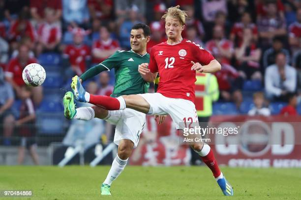 Rafael Marquez of Mexico is challenged by Kasper Dolberg of Denmark during the international friendly match between Denmark and Mexico ahead of the...